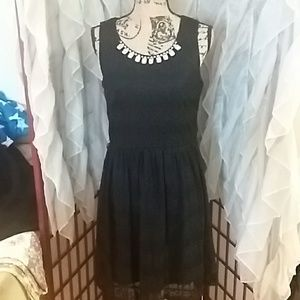 Gorgeous jeweled neck black cocktail dress. Large